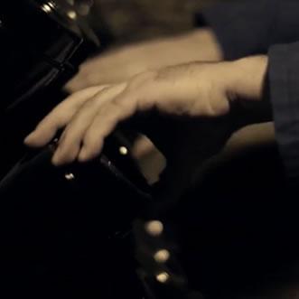 hands riddling bottles